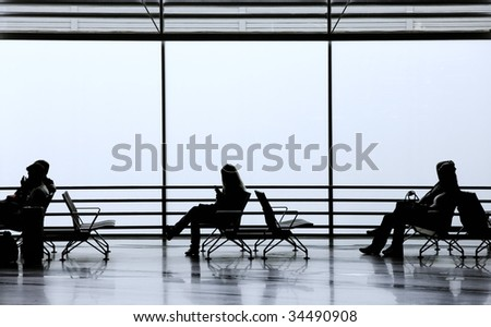 People waiting in transit - stock photo