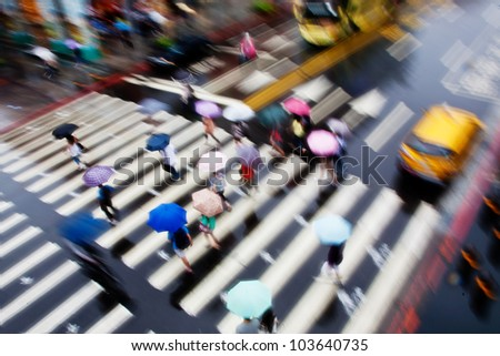 people walk fast in the rain - stock photo