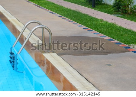 people walk form ladder pass garden around the pool