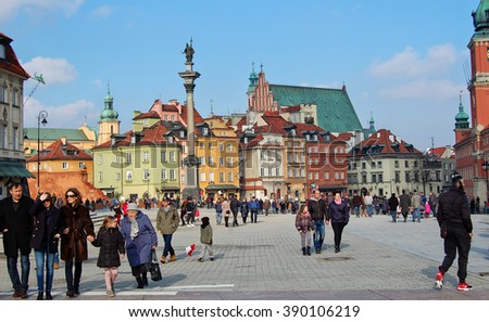 People walk in Old Town. Travel to Europe./ WARSAW, POLAND - FEBRUARY 14, 2016: People walk on Castle Square & enjoy a weekend on a background of Old Town, the Column of King Zygmunt & ancient houses