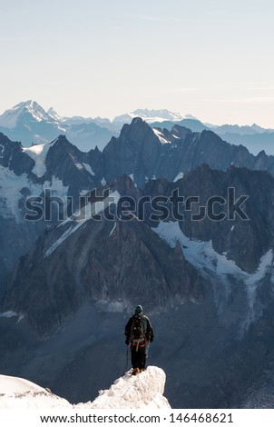 people walk on a glacier in the mountains - stock photo