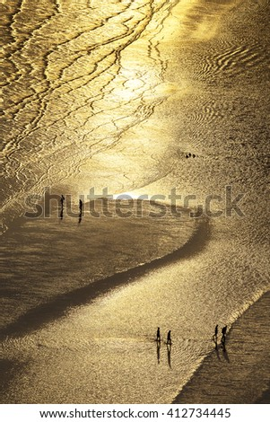 people walk on golden beach of Chao Laow in Chanthaburi province east of Thailand - stock photo