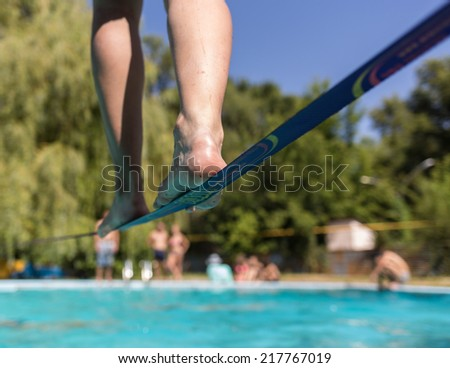 People walk on the sling over the water - stock photo
