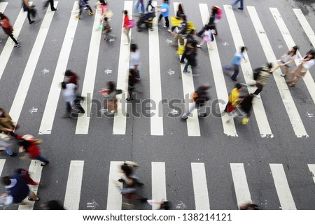 people walk through the road - stock photo