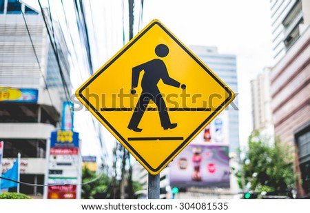 People Walk Traffic Signs in City - stock photo