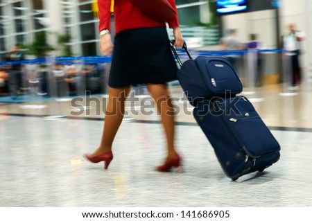 People walking at airport (motion blur) - stock photo