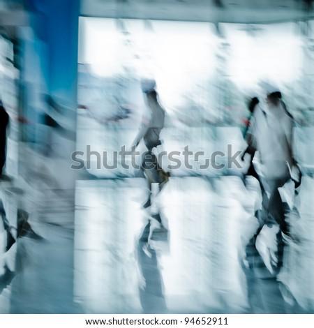 people walking crowd blur motion - stock photo