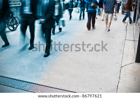 People walking different directions. Two way busy street. Pavement. - stock photo