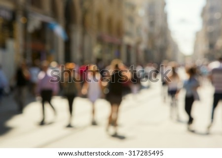 People walking down the street, namely ''Istiklal street '' in Istanbul.The photo is purposely made out of focus  - stock photo