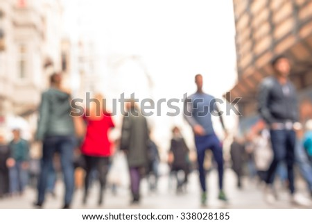 People walking down the street namely '' Istiklal  '' which is one of the main shopping area in Istanbul.The photo is purposely shot and made out of focus - stock photo