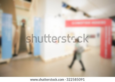 People walking, generic background. Intentionally blurred post production.