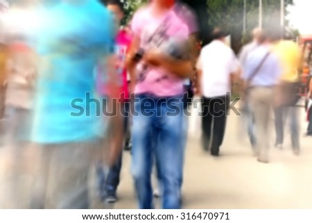 People Walking in a Hurry ,commute Unrecognizable Crowded people  out of focus - stock photo