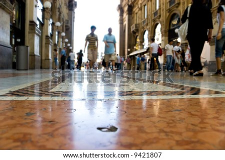 People walking in a trade center Milan Italy. Focus on a ground. - stock photo
