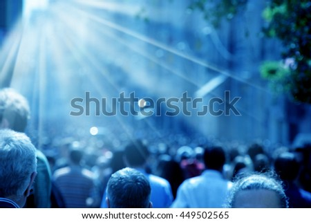 people walking in crowded busy street - stock photo