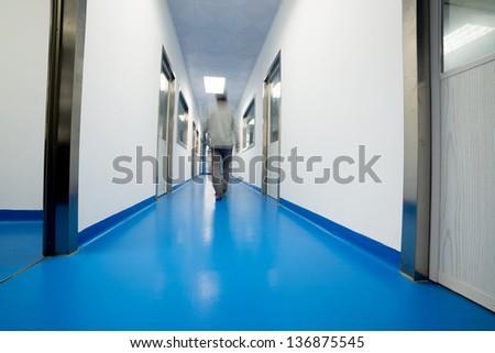 people walking in modern laboratory, blur motion. - stock photo
