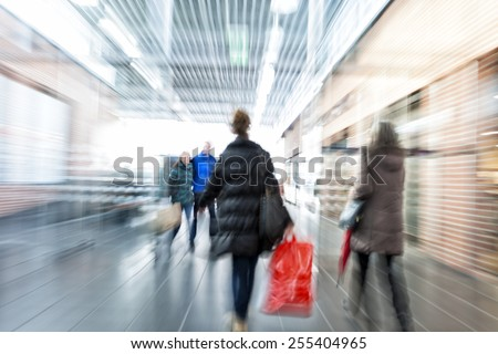 people walking in shopping center - stock photo