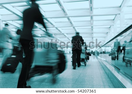 People walking in the airport - stock photo