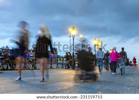 People walking in the beautiful city of Stockholm on late summer evening - stock photo