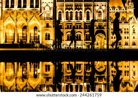people walking in the city by night - stock photo