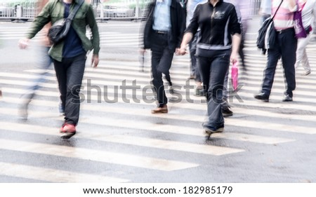 People walking on big city street - stock photo