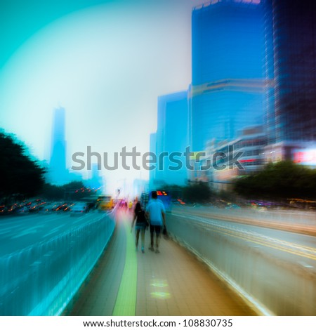 people walking on big city street, blurred motion abstract - stock photo