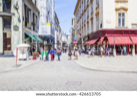 people walking on busy street in the city ,blurred urban background