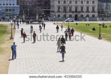 People walking on the grounds of Canada's Parliament - May 3, 2016 - Ottawa, Ontario Canada - stock photo
