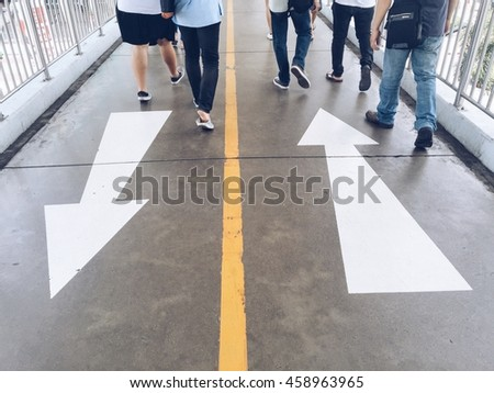 People walking on the walk lane.