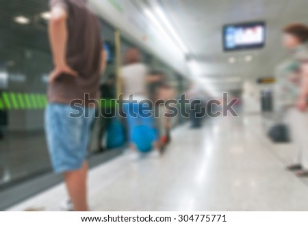 People walking on train station, blurred background
