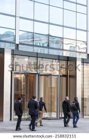 People walking past a office building - stock photo