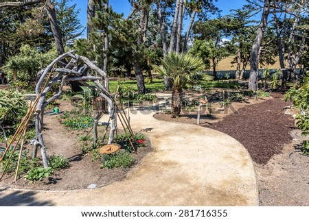 People walking, picnicking, and playing at the Centrally Grown restaurant / cafe & bar. Next to the Big Sur Highway (California State Highway 1) on the California Central Coast, near Cambria, CA. - stock photo