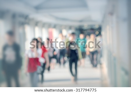 People walking slowly on modern city pave way shot with lens blur - stock photo