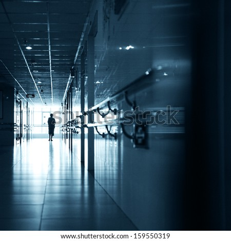 People walking through the hospital corridor.  - stock photo