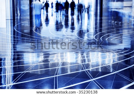 People walking thru the mall. A shopping mall. Long exposure for intentional motion blur of people. - stock photo