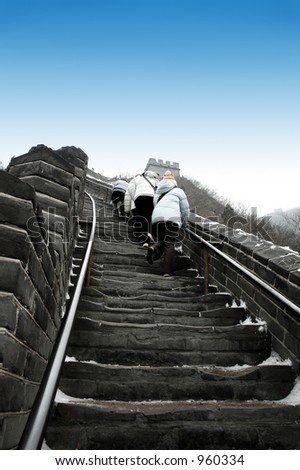 People walking to the top of  The Great wall China - stock photo