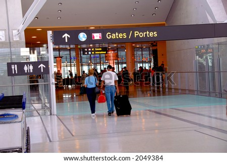 People walking towards gates at modern internation airport - stock photo