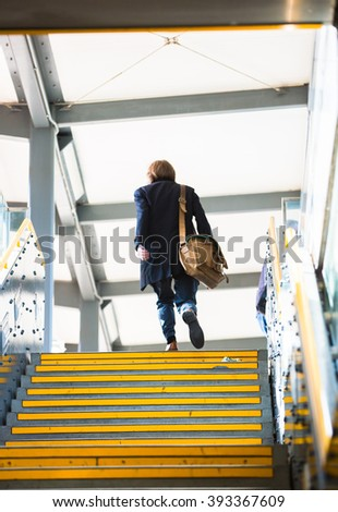 People walking up to stairs, abstract background blur