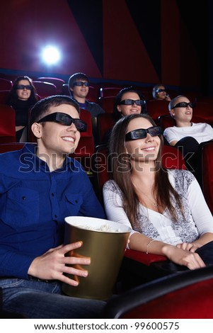People watch a movie in 3D glasses in the cinema