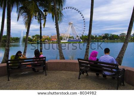 People watching Eye On Malaysia at  Lake Titiwangsa, Kuala Lumpur, Malaysia - stock photo