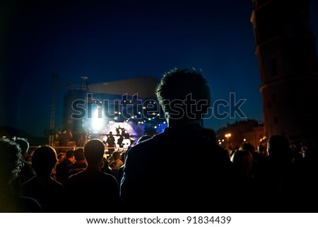 people watching open air concert - stock photo