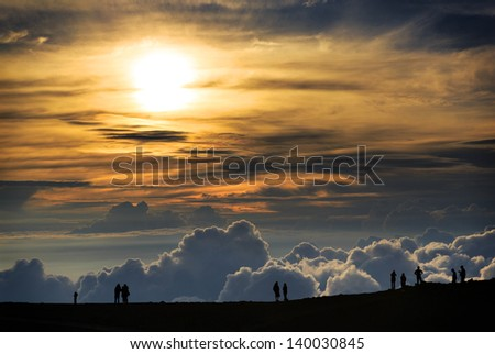 People watching the sunset at the summit of Haleakala Volcano on Maui - stock photo
