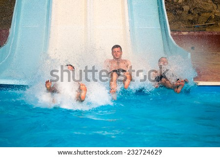 People water slide at aqua park. - stock photo
