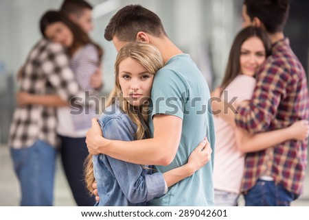 People we can trust. Group of depressed people hugging each other.