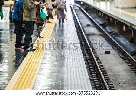 People who walk the platform of the station, scene - stock photo