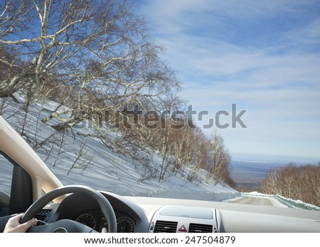 People winter driving in mountain area - stock photo