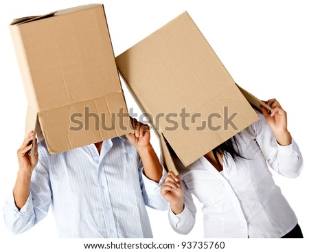 People with cardboard boxes on their heads simulating a crazy moving - isolated - stock photo