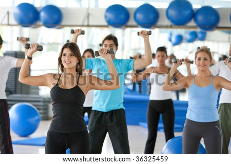 People with freeweights at a gym class - stock photo