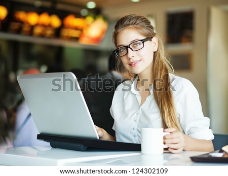 People with laptop (soft focus on eyes) - stock photo