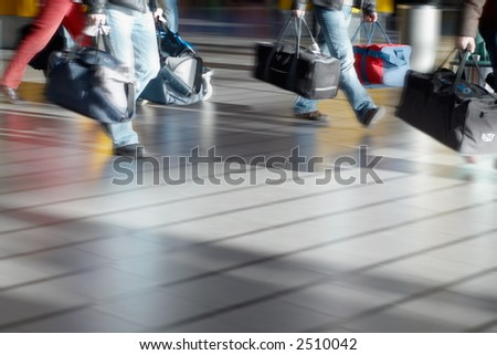 people with luggage at the airport (Blurry!) - stock photo
