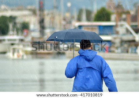 people with umbrella walking under the rain